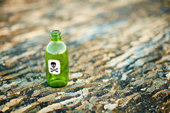 Green glass bottle from poison Royalty Free Stock Photography