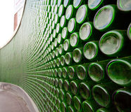 Green glass bottle wall Royalty Free Stock Photo