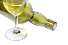 Green glass bottle and wineglass of dry wine Stock Images