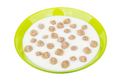 Green glass bowl with yogurt and extruded rye bran Royalty Free Stock Photos