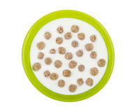 Green glass bowl with yogurt and extruded rye bran. Isolated on white background. Top view Royalty Free Stock Image