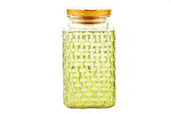 Green glass container. Green mozaic glass container over white background Royalty Free Stock Images