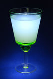 Green glass with a drink Royalty Free Stock Photo