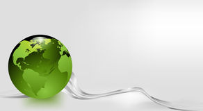 Green glass earth on a silver grey background Stock Photography