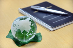 Green glass globe and Note. Royalty Free Stock Photos