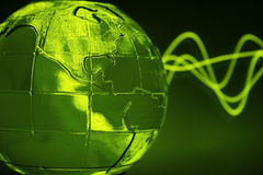 Green glass globe & wave Stock Image