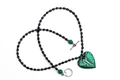 Green glass heart crystal necklace isolated       Stock Photography