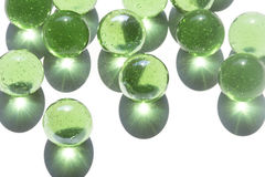 Green glass marbles Stock Photo