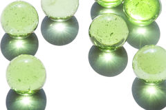 Green glass marbles Stock Photos