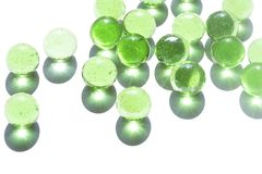 Green glass marbles royalty free stock photo