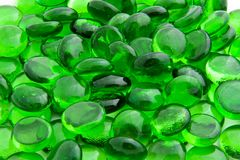 Green glass pieces. Small green pieces of glass on the bright light Royalty Free Stock Photography