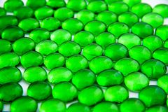 Green glass pieces. Small green pieces of glass on the bright light Royalty Free Stock Photos