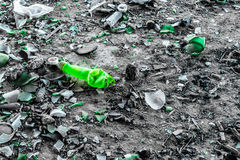 Green Glass and Plastic on A Dusty Floor Stock Photos