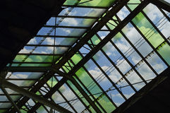 Green glass roof detail of train station over blue sky, Bangkok Stock Photos
