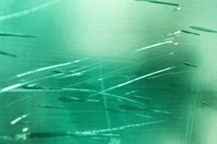 Green glass with scratches, background, blur, copy space. Horizontal stock images
