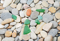 Green glass and sea pebble Stock Photos