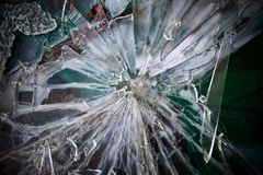 Green glass shards. Sharp pieces of a window smashed broken royalty free stock image