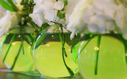 Green glass vase. Spectacle of green glass vase in room Royalty Free Stock Photography