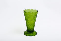Green glass vase on a white background. Green glass design vase on a white background Stock Images