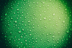 Green Glass With Water Drops Royalty Free Stock Images