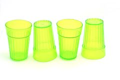 Green glasses. Line of four green drinking glasses - isolated on white stock photo