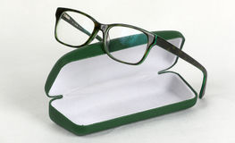 Green glasses with box. Green glasses on top of green box, white background Stock Photography