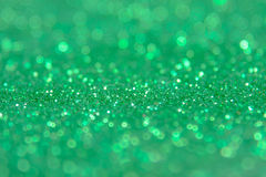 Green glitter abstract background with bokeh defocused lights.  stock illustration
