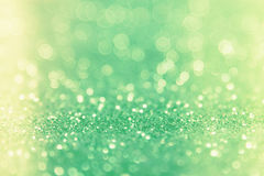 Green glitter abstract background with bokeh defocused lights.  vector illustration