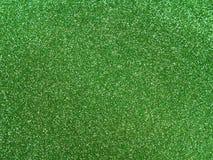Green glitter background. Green shiny glitter for the background Stock Photo