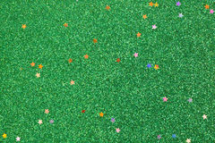 Green glitter background with small stars Stock Photo