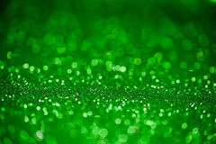 Green glitter surface with green light bokeh Stock Photography
