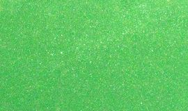 Christmas New Year Green Glitter background. Holiday abstract texture fabric. Element, flash. royalty free stock photo