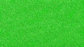 Green glittery confetti texture for cheerful and festive designs. Green glittery blank surface. shining background texture for festival and celebration designs Stock Image