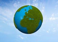 Green globe. Green grass world globe in the sky Royalty Free Stock Photography
