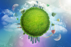 Green globe with city and rainbow Stock Images