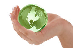 Green globe in female hand Royalty Free Stock Photo