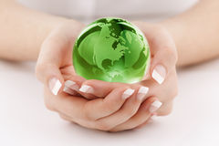 Green globe in hands Royalty Free Stock Photography