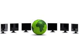 Green globe and lcd monitors Royalty Free Stock Image