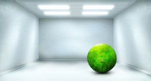 Green globe in light room Stock Photo