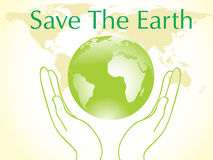 Green globe between two hands Stock Image