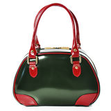 Green glossy leather bag with red handles on a white background. Green bag with gold fittings, photographed close-up Stock Photography