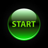Green glossy start button on black Stock Photos