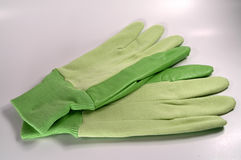 Green Gloves. Photo of Green Gardening Gloves Stock Photos