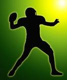 Green Glow SilhouetteFootball Quarterback. Green Glow Silhouette American Football Quarterback Aiming to Throw Ball Stock Photos
