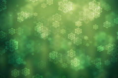 Green glowing background, with snowflakes Royalty Free Stock Images