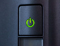 Green glowing power button. Closeup Royalty Free Stock Photos