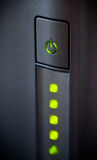 Green glowing power button. Closeup shot Royalty Free Stock Image