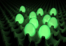 Green glowing, radiating eggs in common egg packaging, boxing Stock Images