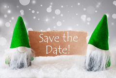 Green Gnomes With Snow, Text Save The Date. English Text Save The Date. Christmas Greeting Card With Two Red Gnomes. Sparkling Bokeh And Noble Silver Background Royalty Free Stock Photography