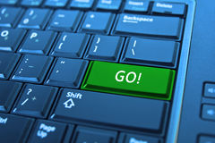 Green go button on computer keyboard Royalty Free Stock Images